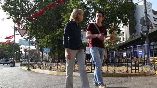 Bethany Bell talking to Ferhad Ercumen