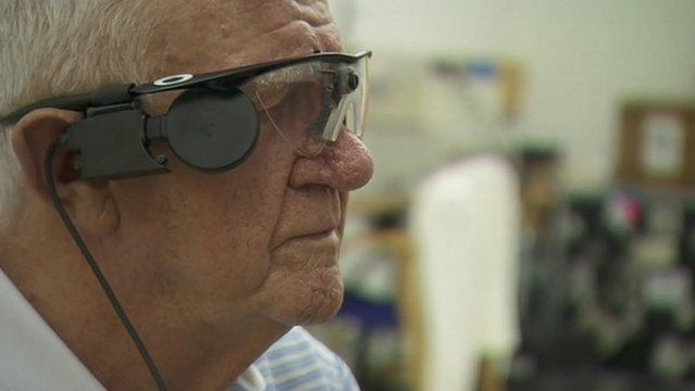 Visual signals from the camera on Ray's glasses are sent to the implant at the back of his retina
