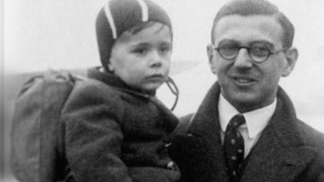 Sir Nicholas Winton carrying a child.
