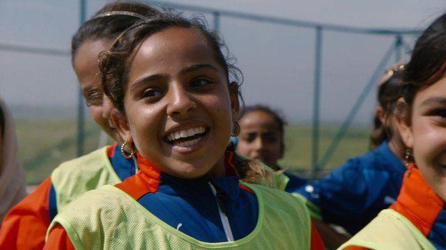Girls playing football in Iraq
