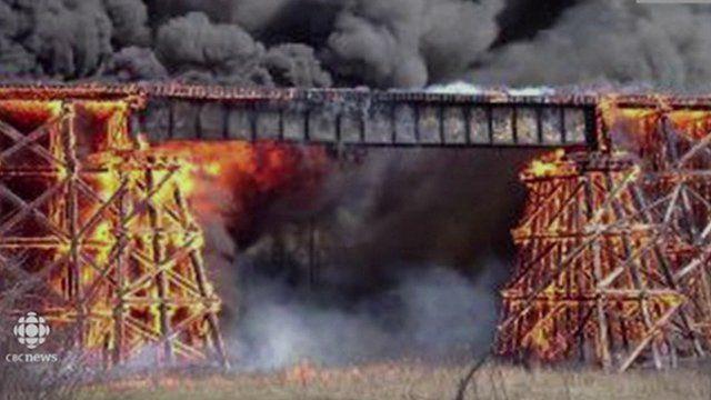 Fire engulfs a rail trestle bridge in Mayerthorpe, Canada