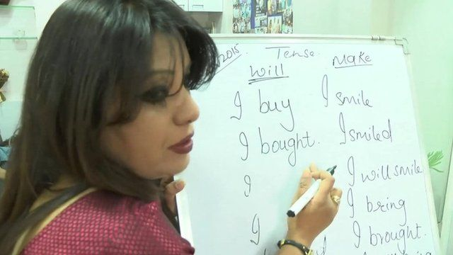 An Indian lady teaching English