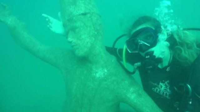 Diver with whirling dervish sculpture