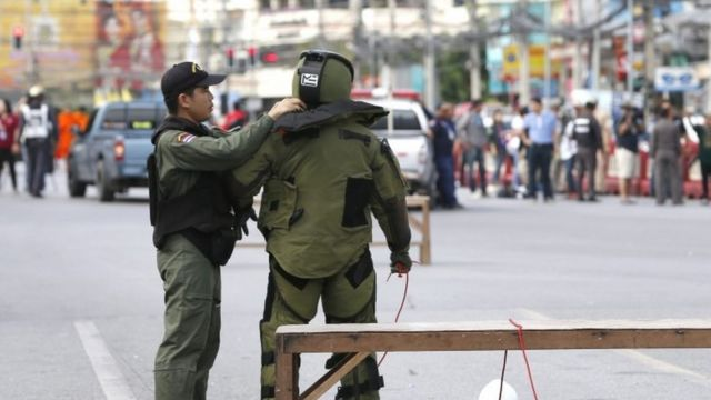 A Thai members of Explosive Ordnance Disposal (EOD) helps his colleague in the centre of Hua Hin city, Thailand