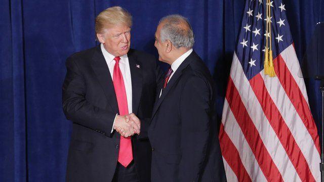 Ambassador Zalmay Khalilzad welcoming Donald Trump to stage