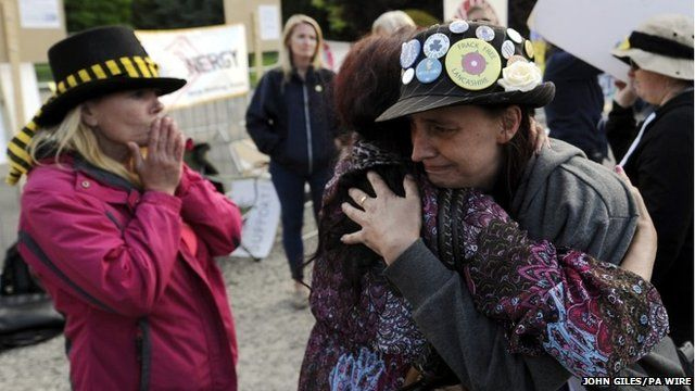 Protesters embrace after fracking application approved in Northallerton