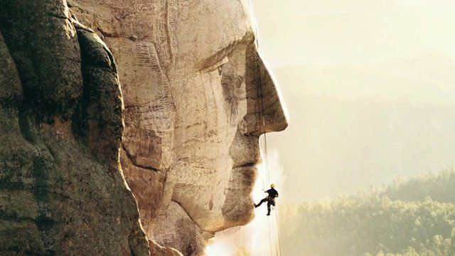 Man cleans Mount Rushmore