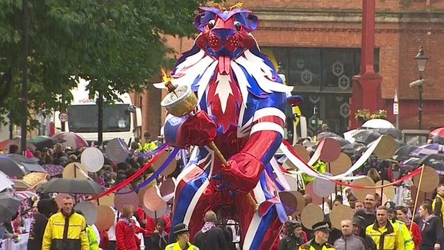 The Olympic parade makes its way to Albert Square in Manchester.
