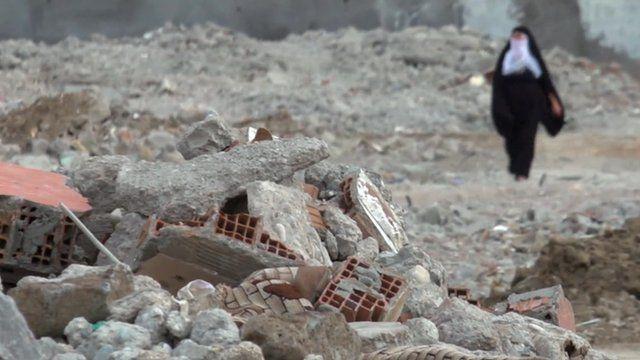 Woman amid rubble in Cizre