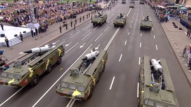 Military tanks and crowds