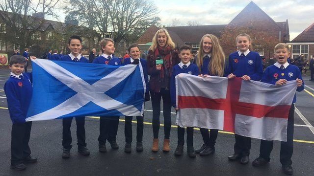 Jenny with school children