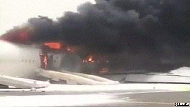 Plane on fire on Dubai runway