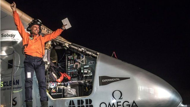 Pilot celebrating the solar impulse landing