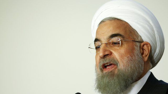 Iran President Hassan Rouhani talks during a business forum in Rome, Italy