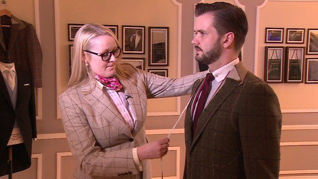 Kathryn Sargent measuring customer for a suit