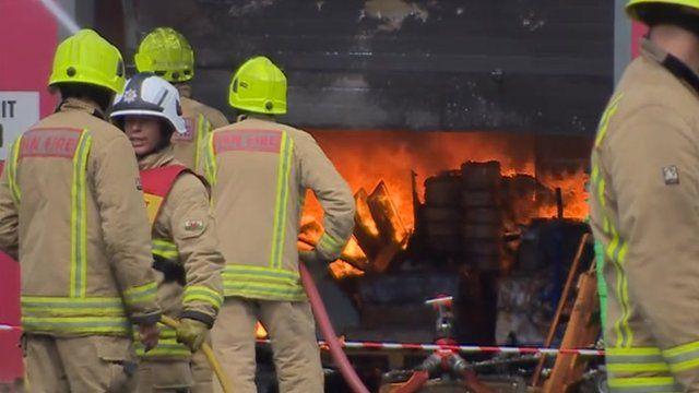 Firefighters tackle a blaze at D'Arcy Business Park, Llandarcy, near Neath,