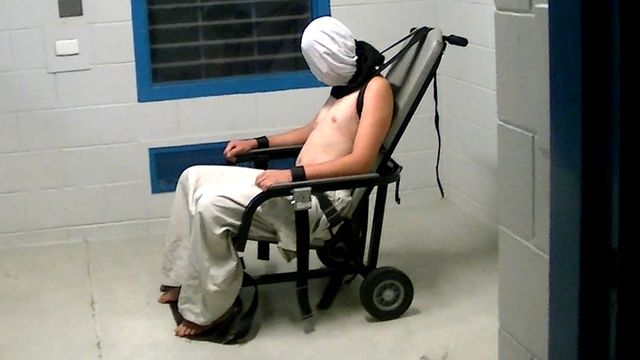 Dylan Voller is shown hooded and strapped into a chair in 2015