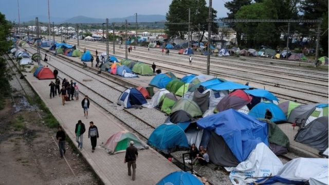 Migrants in tents at a train station in Greece