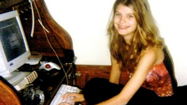 Alicia, age 13, at the family computer