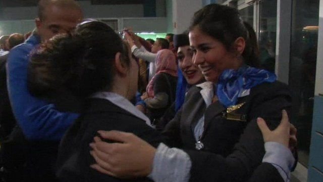 Crew members greeted as they arrive back at Cairo airport