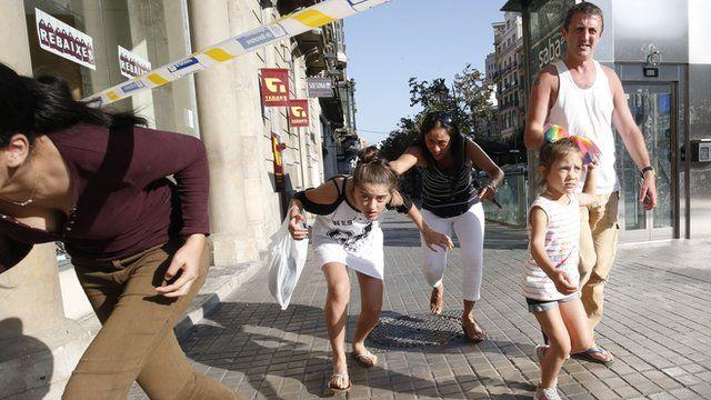 People leave a cordoned area on Las Ramblas, Barcelona