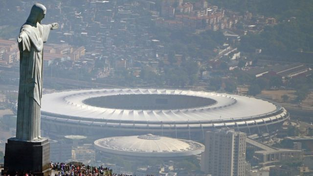 Christ the Redeemer statue overlooking the Maracana Olympic Stadium in Rio de Janeiro