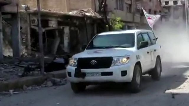 A ground convoy arrives in Darayya, Syria.