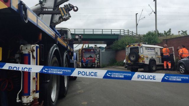 Emergency services at the scene where five men died after a wall collapsed at a Hawkeswood Metal recycling plant