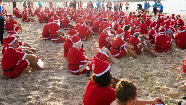 Surfing santas at Bondi beach