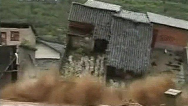 House toppled by flood waters