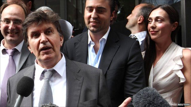 Ejup Ganic with his son and daughter outside court in London
