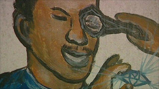 Mural of man examining diamond