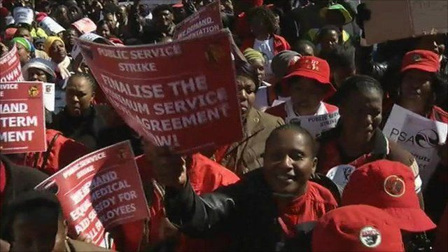 Striking workers with placards
