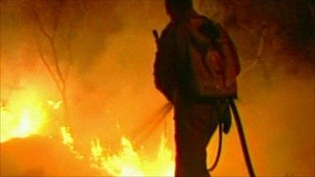 Fire fighter tackles Brazil wildfire