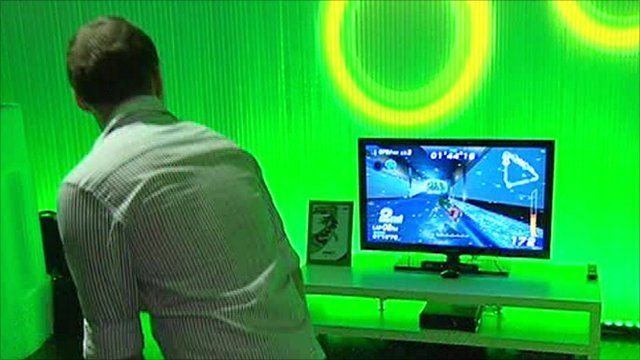 Man playing game using Kinect motion controller for the Xbox 360 at Gamescom, Cologne