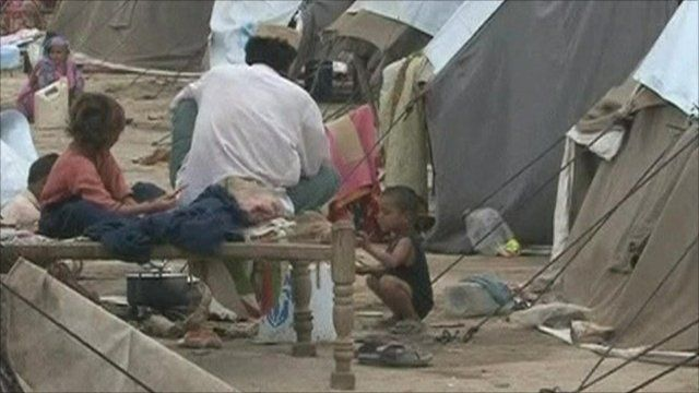Flood victims in a makeshift camp