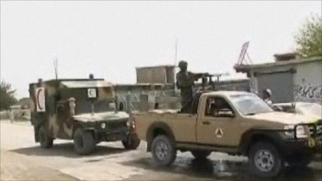 Afghan army vehicles near attack site