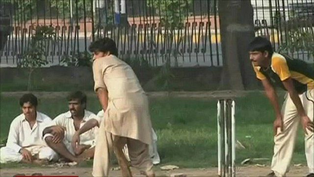 Men playing cricket in Islamabad park