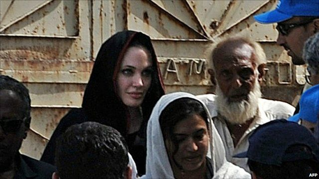 Angelina Jolie with refugees in the Azakhel camp