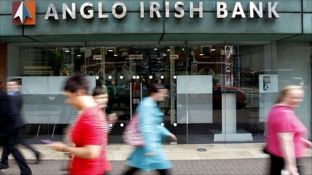Pedestrians walk past a branch of the Anglo Irish Bank in Belfast