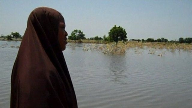 Woman looking at flooded area