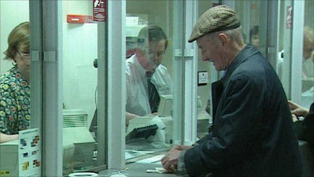 A pensioner withdrawing his pension