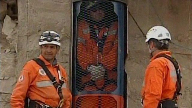 Miners test escape capsule