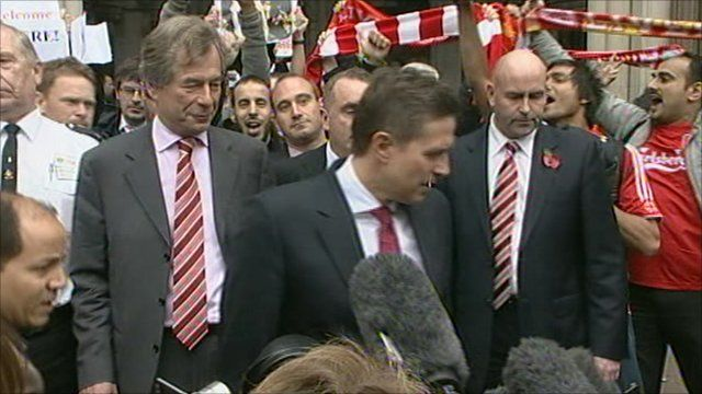 Martin Broughton and Christian Purslow outside court