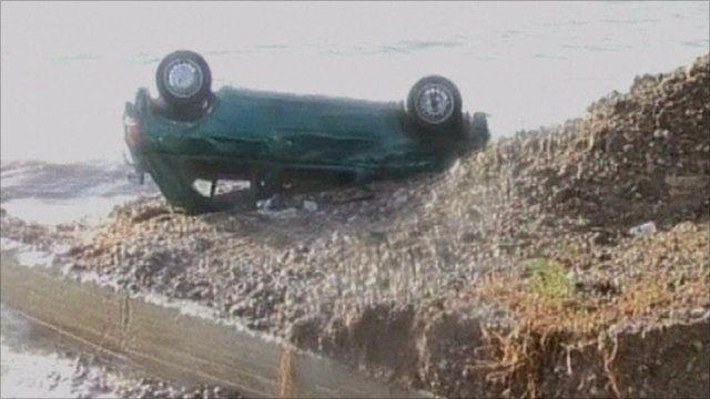 Overturned car on beach