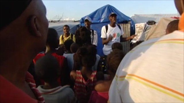 Performers in a Port-au-Prince camp