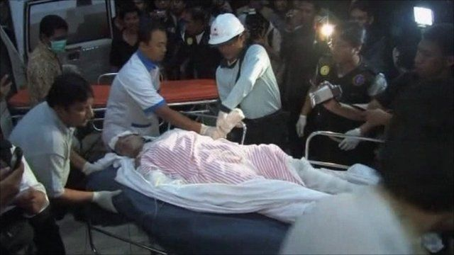 Man on stretcher surrounded by medical staff