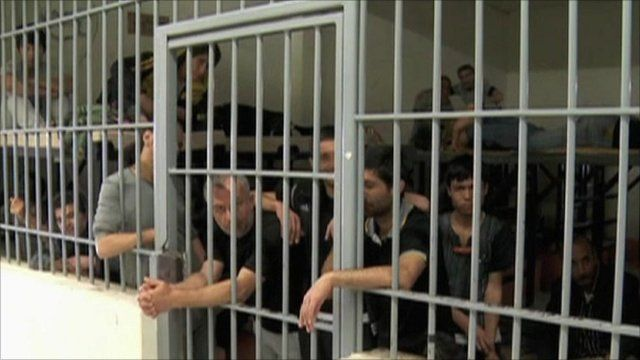 Migrants arrested in Greece crammed into jail cell