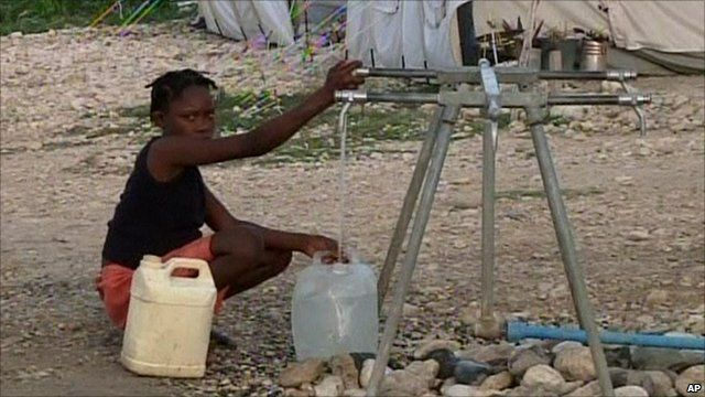 Woman filling water container