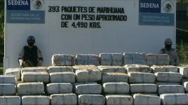 Mexican police with seized marijuana